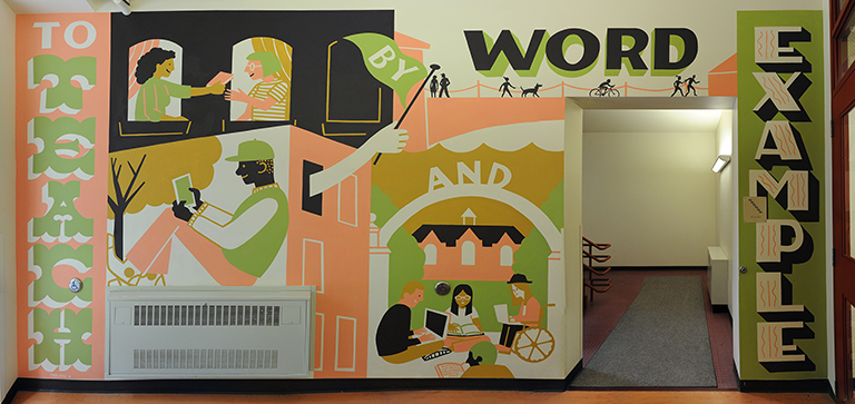 An image of a mural painted by artist Shelby Rodeffer. The mural is pink, green, tan, black, and white and includes the motto of St. Norbert College: to teach by word and example.